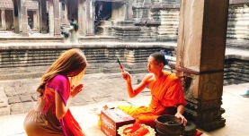 Be blessed by a monk in Cambodia